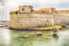 Defocused background of Angevine-Aragonese Castle in Gallipoli, Italy - stock photo