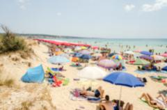 Defocused background of a crowded beach in Salento, Apulia, Italy Stock Photos