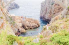 Defocused background of scenic seascape at Ciolo Bridge, Apulia, Italy Stock Photos