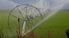 Farm irrigation water and wheels - stock footage