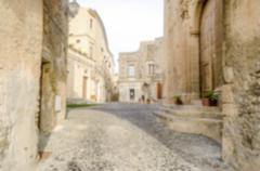 Defocused background of an ancient street in old town Stock Photos