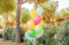 Defocused background with colorful bunch of helium balloons Stock Photos