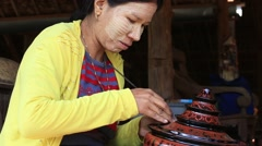 Burmese woman working in a factory of lacquer. Bagan, Myanmar, Burma Stock Footage
