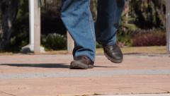 Man legs in brown working shoes coming Stock Footage