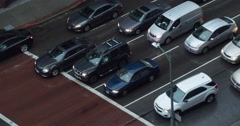 Time lapse of dusk traffic at intersection in Downtown LA Stock Footage