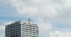 Clouds pass the One Wilshire office building in LA  Stock Footage