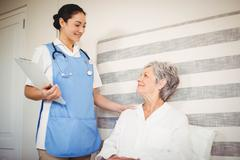 Nurse taking care of sick senior woman Stock Photos