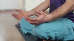 Man practicing yoga. The man sitting in the lotus position and meditate. Stock Footage