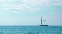 Two Masted Wooden Sailboat, Anchored on the Tropical Horizon. Video UltraHD Stock Footage