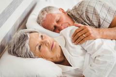 Stock Photo of Senior woman awake on bed