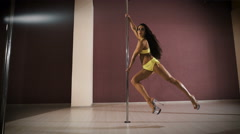 Young sexy woman exercise pole dance. Professional pole dancer Stock Footage