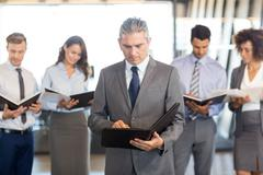 Business team with document and organizer - stock photo