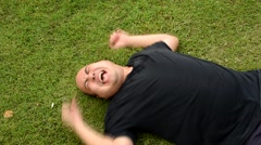 Fat Asian Thai man tantrum like a spoil child having seizures mental illness Stock Footage