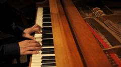 Piano player hands from side - stock footage