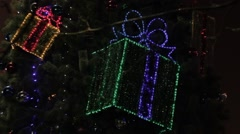 Ungraded: Decorated Christmas Tree With Flashing Gift Boxes and Glowing Lights Stock Footage