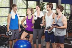 Fit people with sports equipment - stock photo