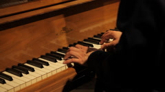 Man's hands playing classical music on a vintage piano - stock footage