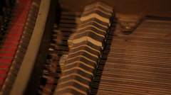 Hammers strings inside vintage grand piano mechanics - stock footage