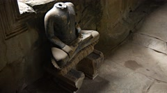 Ancient Religious Sculpture with Missing Head at Angkor Wat. Video UltraHD Stock Footage
