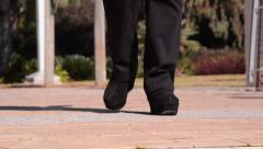 Slightly limping woman coming Stock Footage