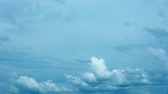 Surreal, abstract shot of puffy clouds, billowing and drifting across a gray Stock Footage