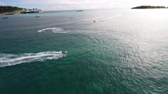 Pursue 3 Jet skis at the beach aerial view Stock Footage