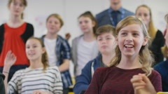4K Happy group of students fooling around in school classroom Stock Footage