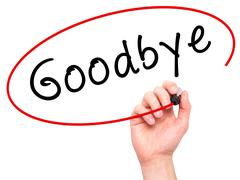 Man Hand writing Goodbye with marker on transparent wipe board - stock photo