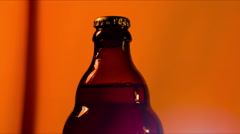 Hand opens bottle Stock Footage