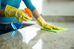 Pretty woman doing her house chores Stock Photos