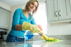 Stock Photo of Pretty woman doing her house chores