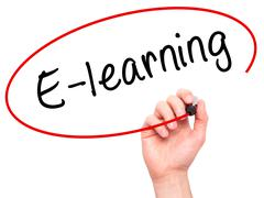 Man Hand writing E-learning with black marker on visual screen Stock Photos
