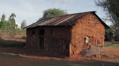 Mud hut in Africa Stock Footage