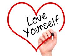 Man Hand writing Love Yourself with marker on transparent wipe board, inside  Stock Photos