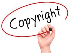 Man hand writing Copyright on visual screen Stock Photos
