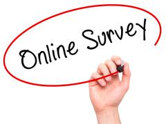 Man hand writing Online Survey on visual screen - stock photo