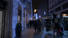 People walking near street stalls on Fashion Street on Christmas in Budapest Stock Footage