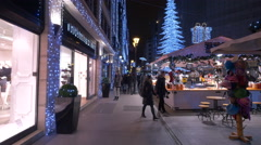 People walking by shops and a food stall on Deak Ferenc on Christmas, Budapest Stock Footage