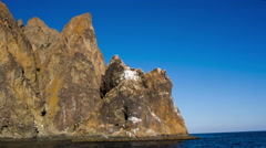 Rocks with white spots against the blue sky Stock Footage