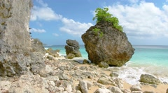 Gentle Waves on a Rocky Tropical Beach, with Sound. UHD video Stock Footage