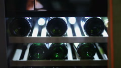 Stock Video Footage of bottles in the wine refrigerator