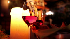 two glasses of wine and a candle - stock footage
