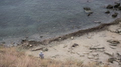 Stock Video Footage of Fisherman on the beach with two rods