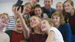4K Teacher & students pose for a selfie in school classroom Stock Footage