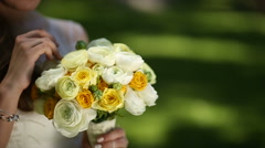 Bride and flowers - stock footage
