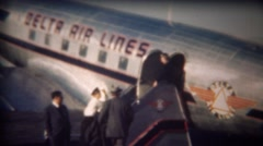 1943: Man entering Delta Airlines airplane via outdoor staircase. Stock Footage