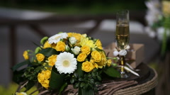 Flowers and goblet are on the table Stock Footage