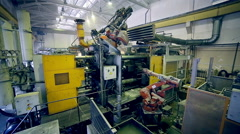 Automatic robot works in production line parts at factory assembling parts - stock footage