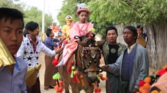 Horse and local people who participated in donation ceremony . Bagan, Myanmar - stock footage