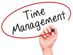 Man Hand writing Time Management with black marker on visual screen Stock Photos